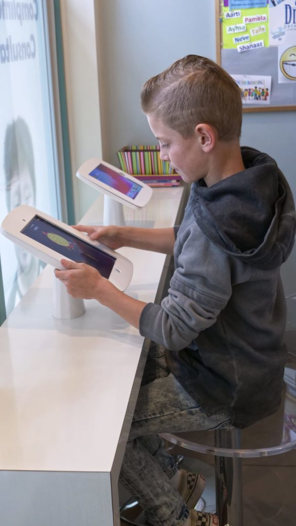 young boy on the office Ipad