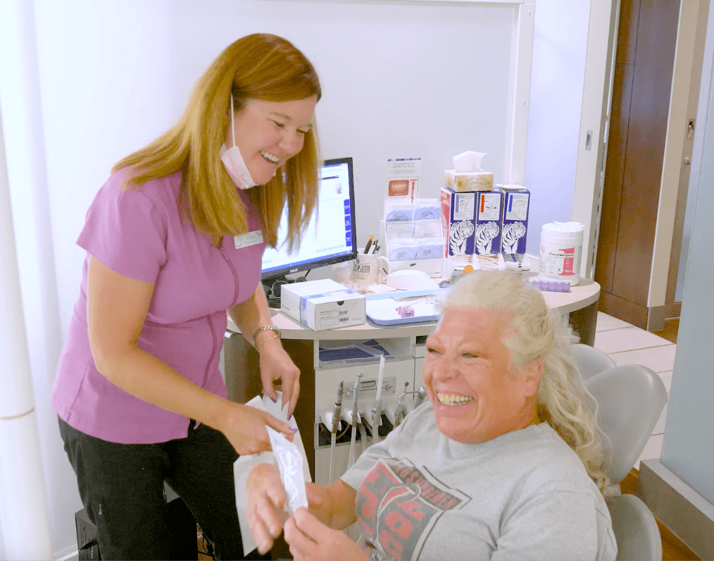 team member laughing with an adult patient