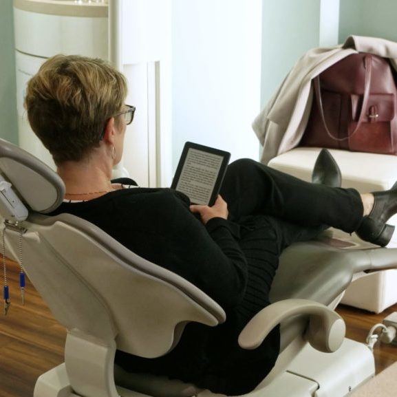 Patient relaxing in a treatment chair